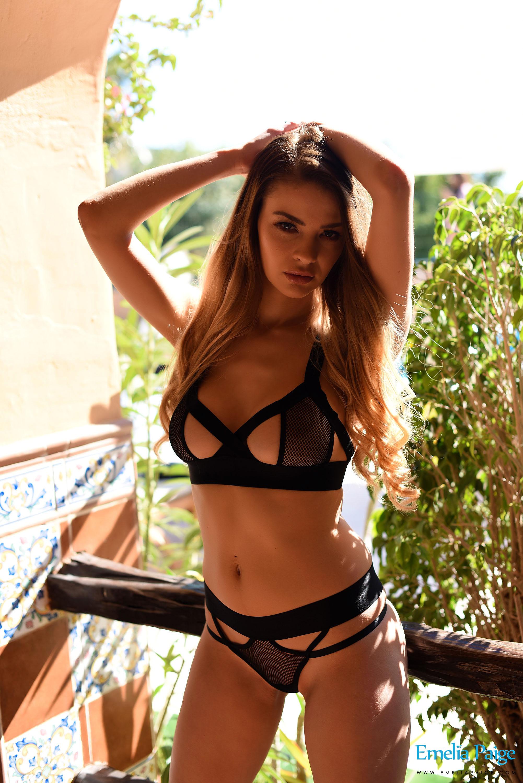 Emelia topless tease
