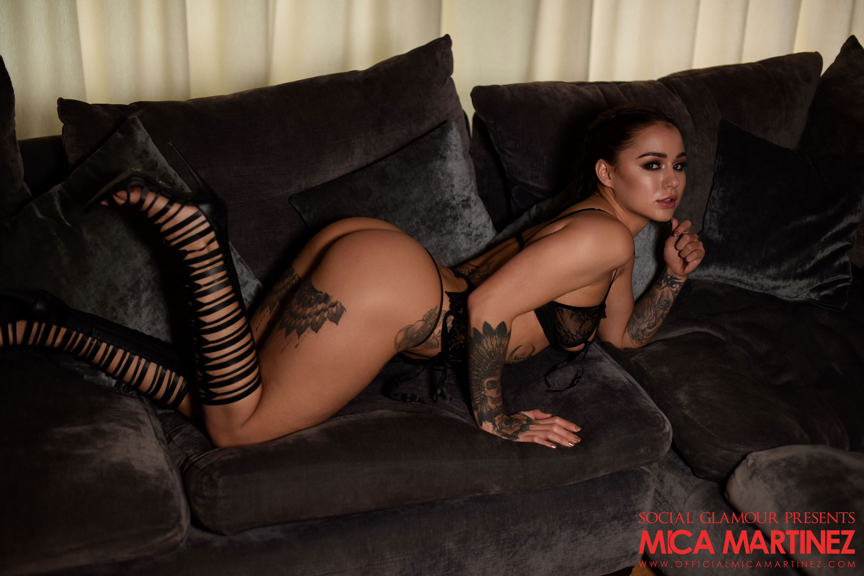 Tattooed vixen in sexy black lace lingerie