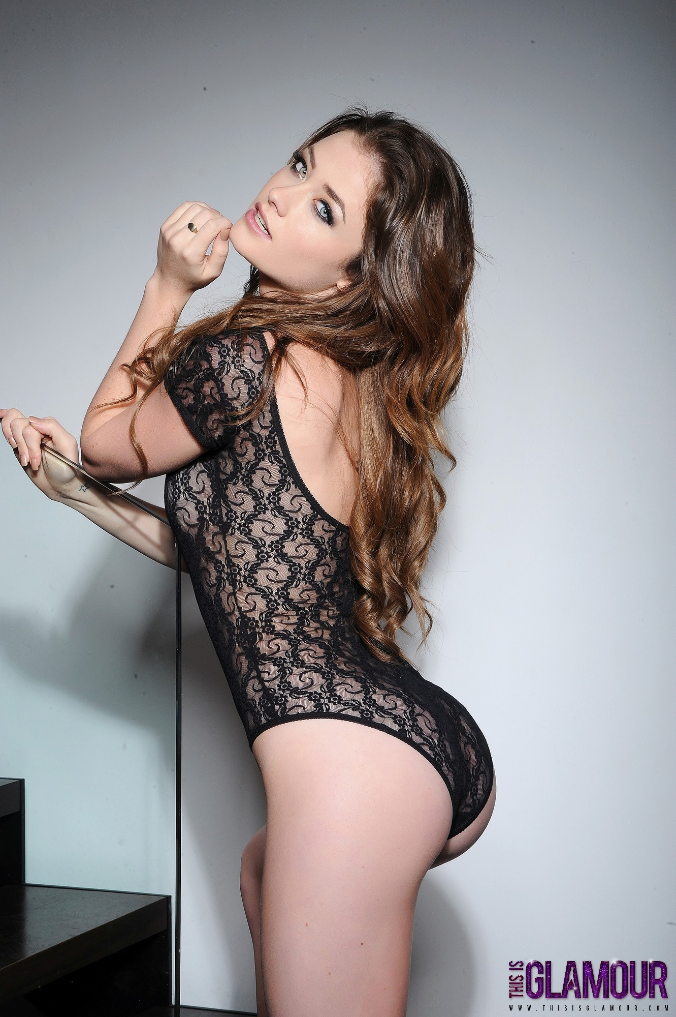 Brunette rocks a lace body suit
