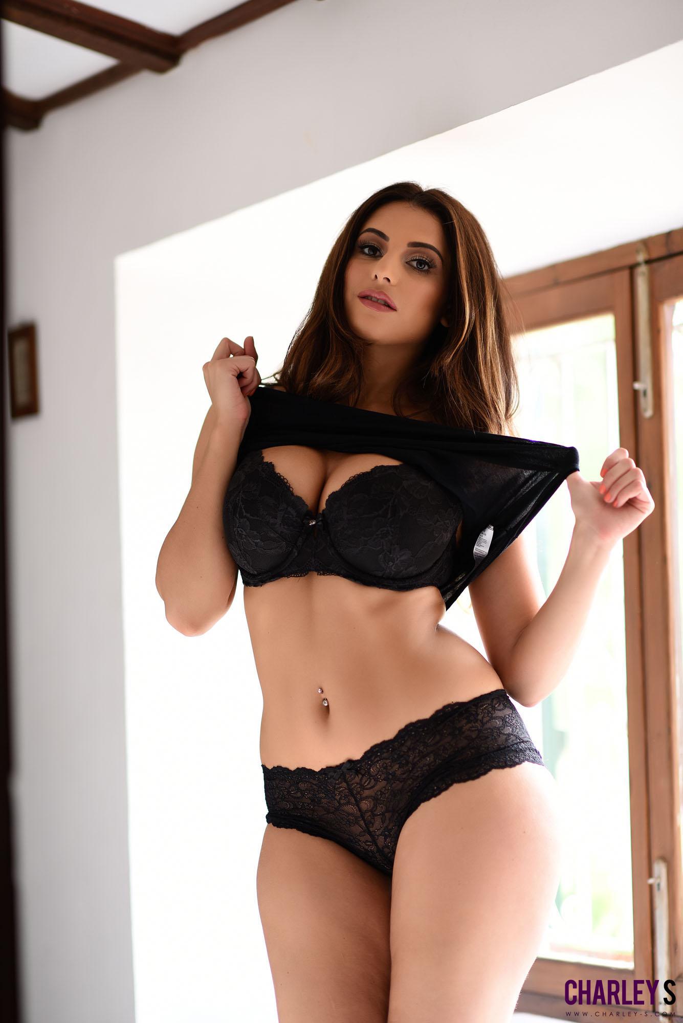 Posing in the window in nothing but her panties & top