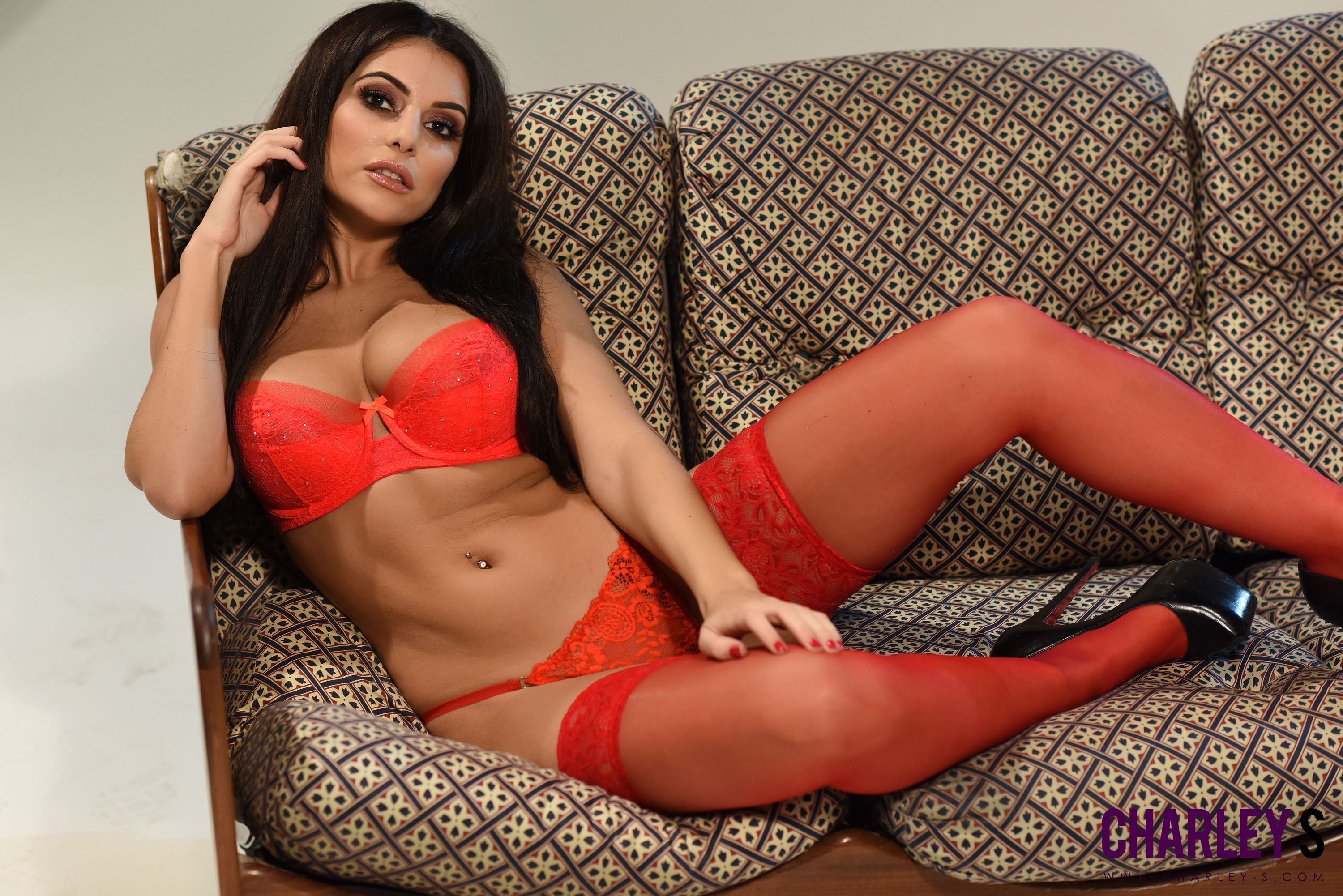 Centerfold looks stunning in her red panties, bra and stockings