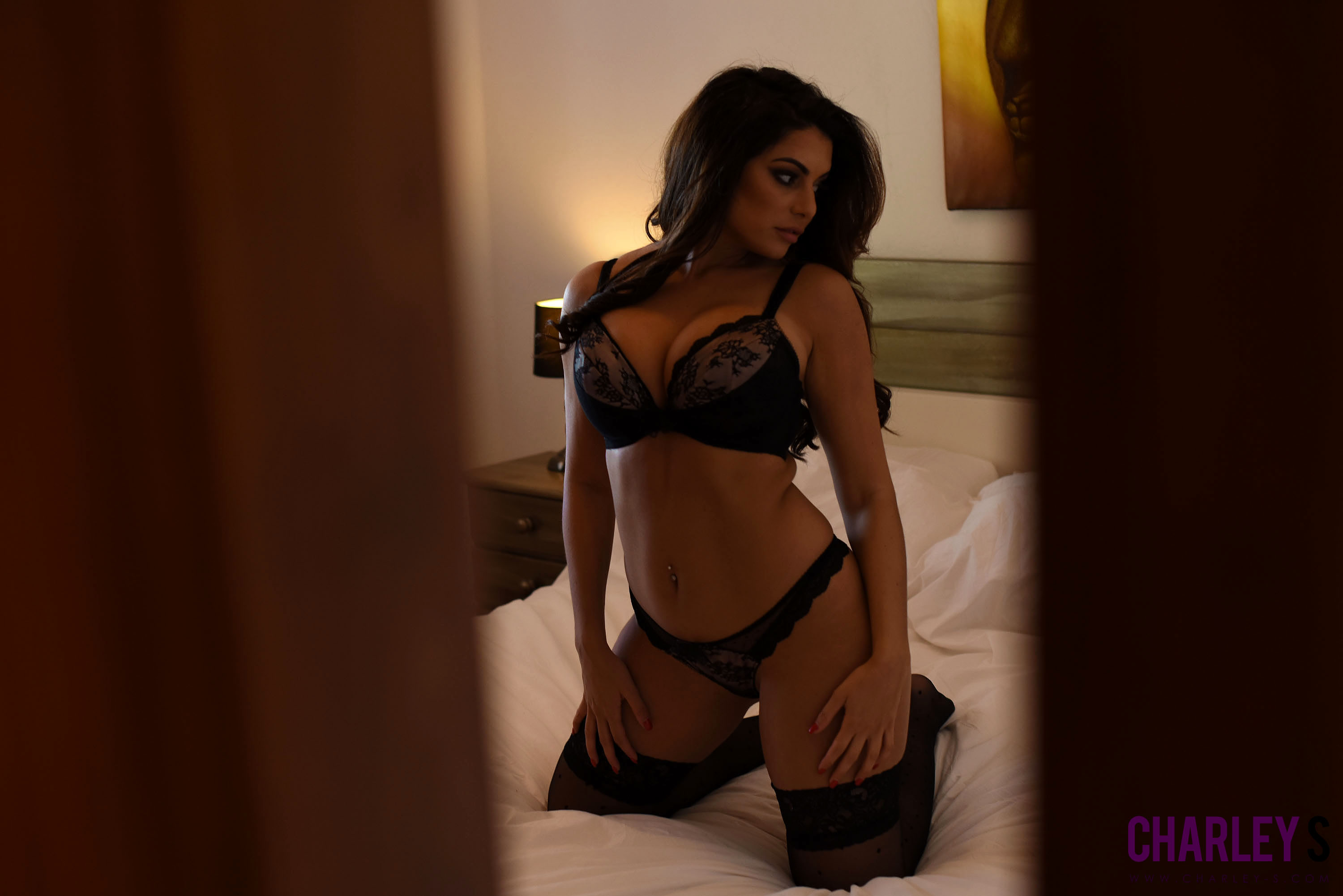 Essex babe Charlotte Springer wearing lingerie in the bedroom