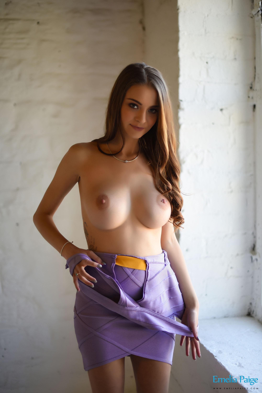 Emelia Paige tin a sexy purple cut out bandage dress