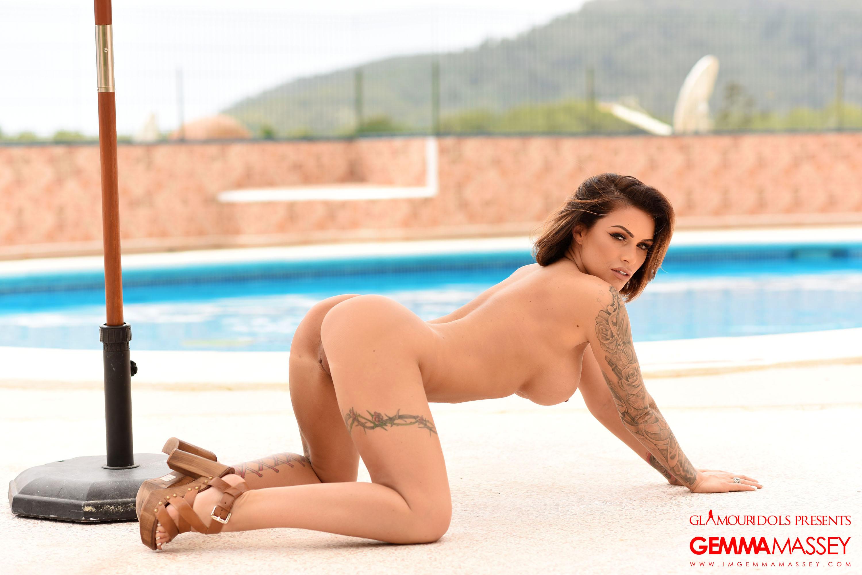 Tattooed bombshell Gemma Massey naked at the poolside
