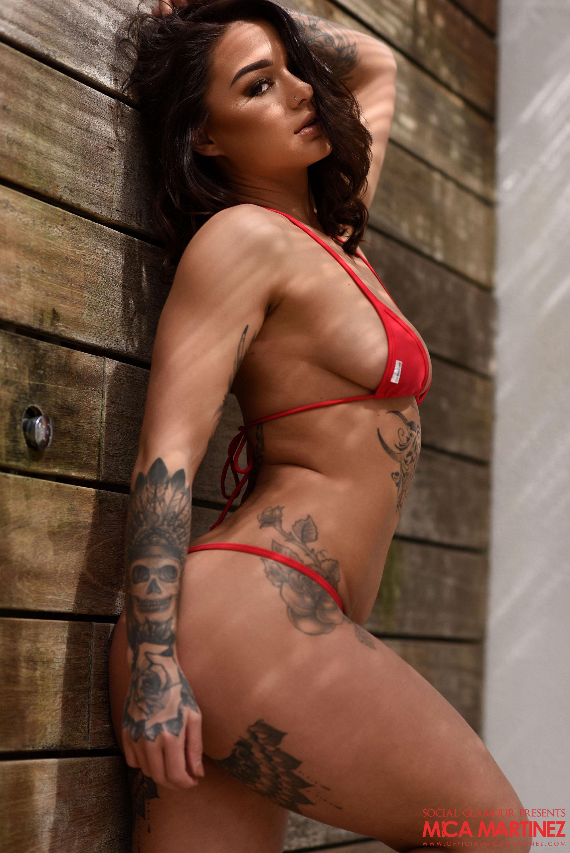 Mica in a very revealling red bikini