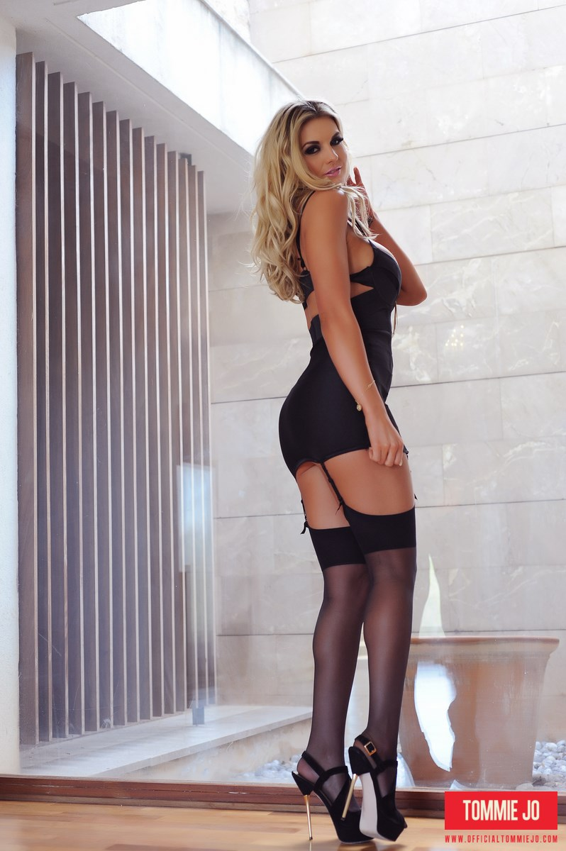 Tommie Jo teasing in a sexy black dress and stockings